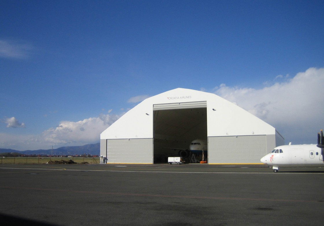 fabric fold up hangar doors for aircraft hangars in all. Black Bedroom Furniture Sets. Home Design Ideas