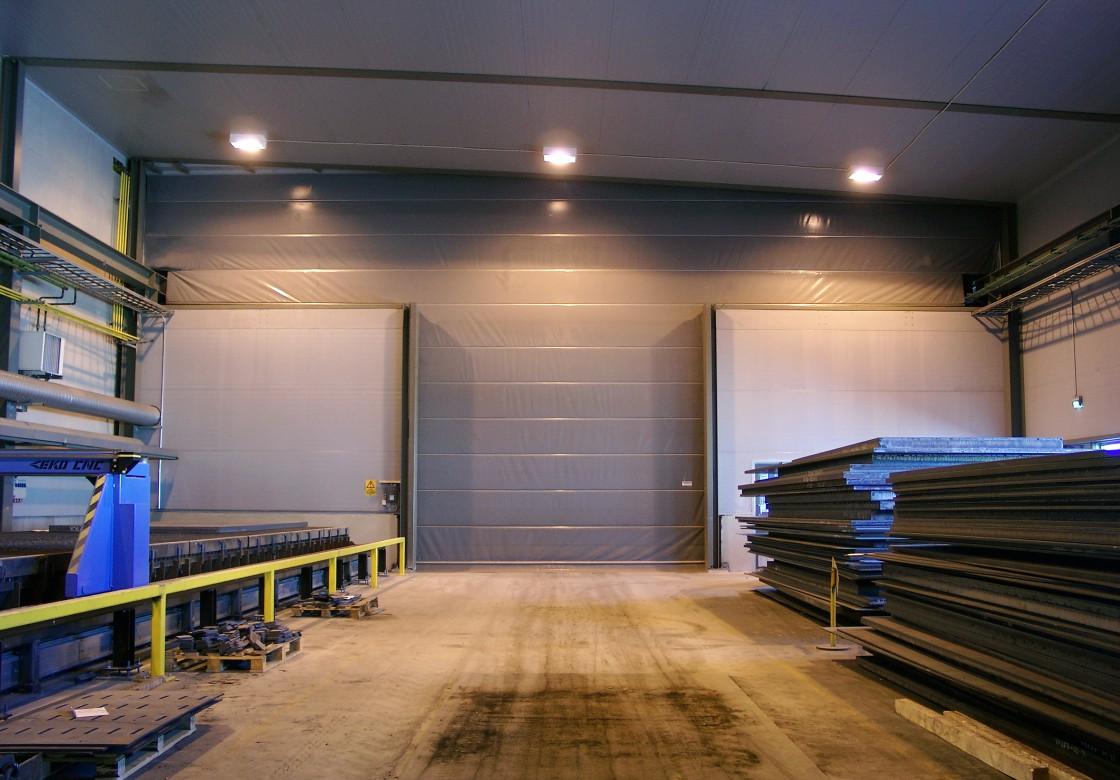 porte pour pont roulant champion door portes de hangar. Black Bedroom Furniture Sets. Home Design Ideas