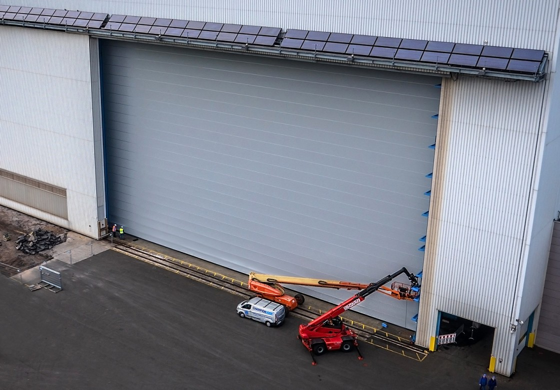 at installation door a garage portfolio commercial doors nh after overhead picture westmorelandnh farm in gallery champion westmoreland