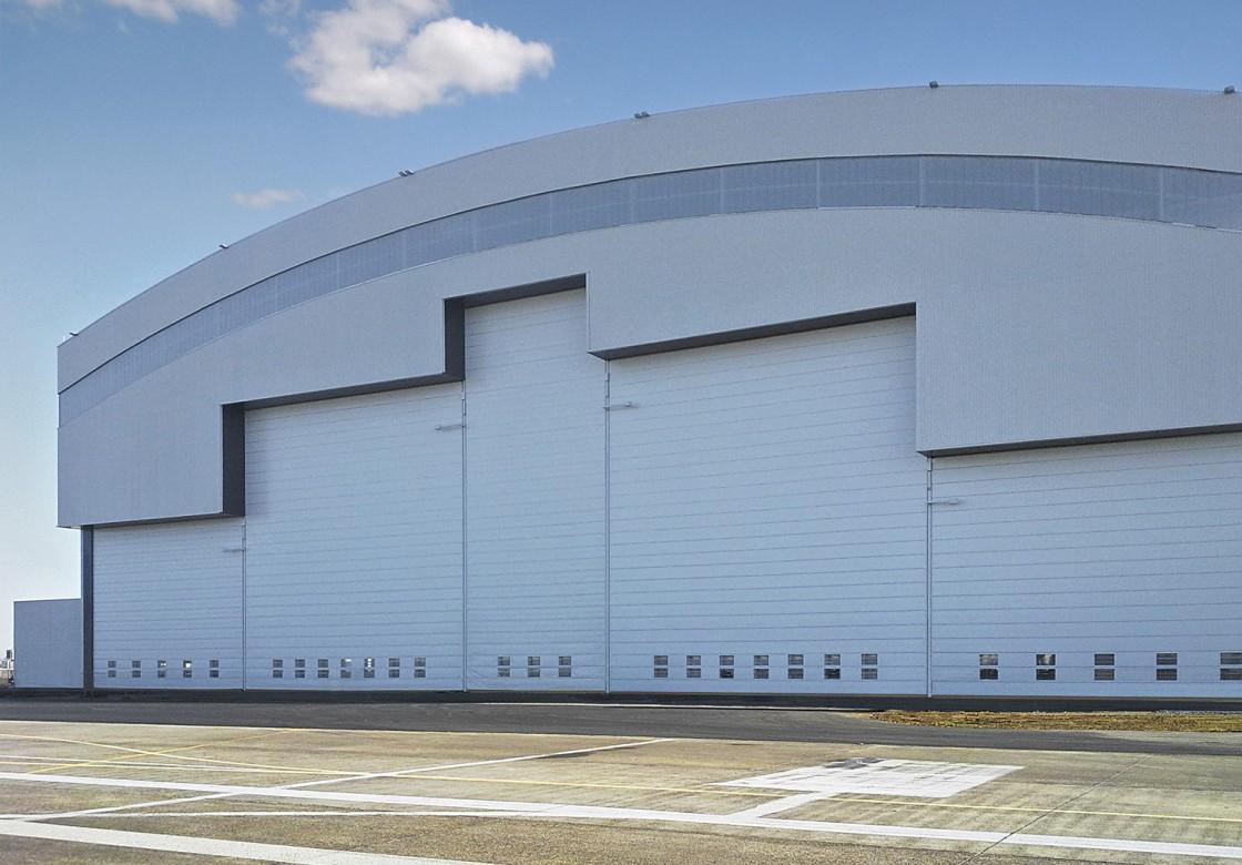 Aircraft hangar doors & Fabric fold-up hangar doors for aircraft hangars in all size ... pezcame.com